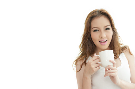 Asian cute woman holding Coffee cup on white Background text space photo