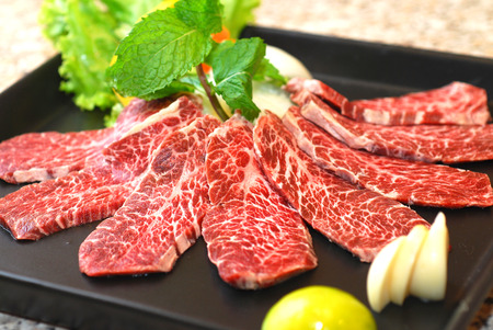 high quality premium Fresh Beef slices on white plate japanese BBQ  grilled menu Imagens