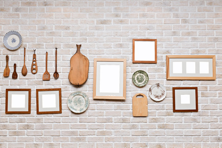 Picture frame in kitchen wall, Photo art gallery on brick wall