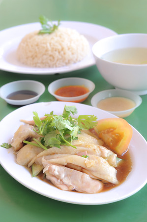 Hainanese chicken rice served at a food court photo