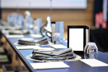 Dinner menu on round table meeting with full course dinner setting photo
