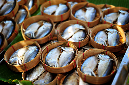 Steamed Mackerel Fish In Bamboo Basket photo