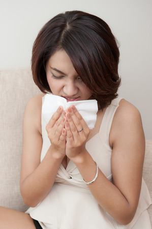 sniffles: woman sick with Flue and fever