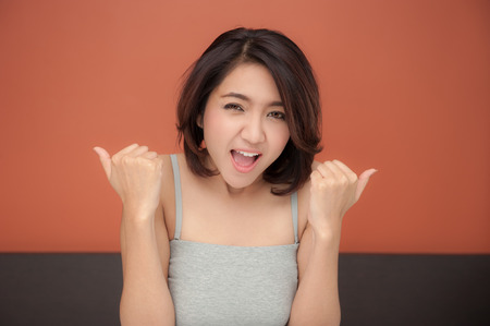screaming asian woman with Excited and happy