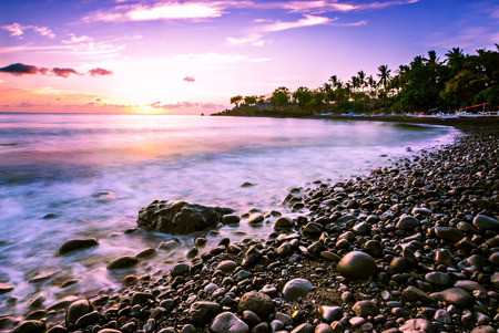 Sunset at Tulamben beach is a small fishing village on the north-east coast of Bali Stock Photo