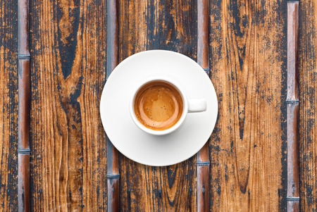 top view a cup of espresso coffee wooden bamboo table