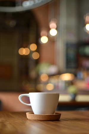 cup of espresso coffee with blur cafe shop background Banco de Imagens