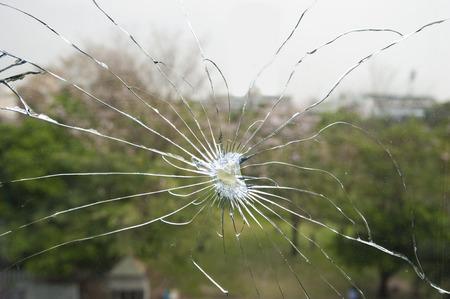 broken glass with garden background