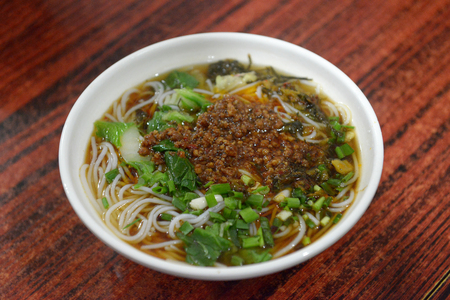 favorite soup: Chinese white noodle with yummy soup noodle seasoned with soy sauce, green onion, chicken broth and sesame oil. The favorite Chinese breakfast foods. Stock Photo