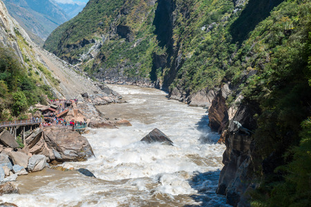 Tiger Leaping Gorge near Lijiang Ancient Town, Lijiang Attractions. One of the deepest canyons in the world r there is a rock in the middle of Golden Sand River called Tiger Leaping Rock in Hu Tiao Xia, Lijiang, Yunnan, China Stock Photo