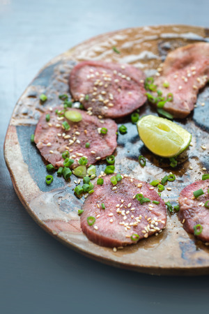 Barbecue sliced beef tongue marinated in pepper, onion, sesame oil and soy sauce.