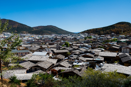tibetan house: top view of vintage traditional chinese roof in shangri la