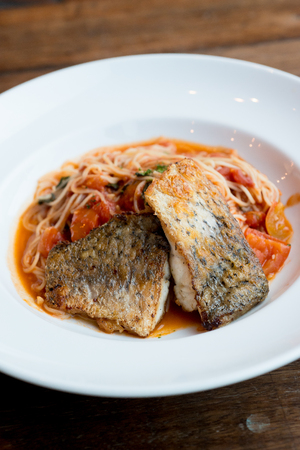 Grilled sea bass and spaghetti with tomato sauce
