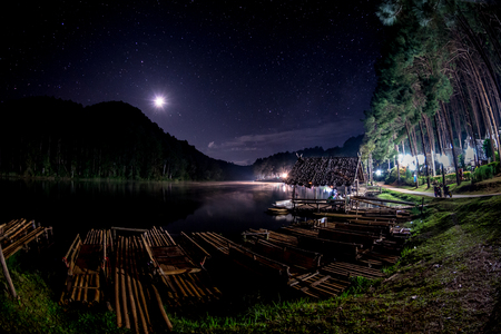 The beautiful night sky with light of moon and milkyway at Pang Ung Lake in Mae Hong Sons city, North of THAILAND.