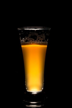 IPA craft beer glass on black background