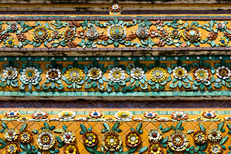 Close up beauitful mosaic tiles of large stupas in Wat Pho or Wat Phra Chetuphon temple 写真素材