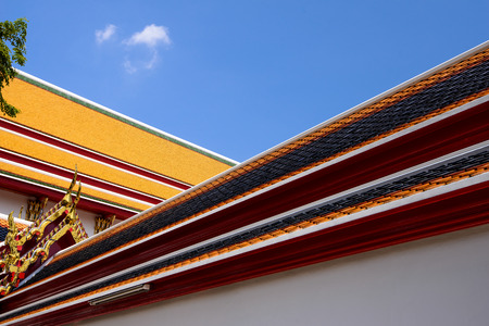 Beauitful temple roof tiles with bluesky at Wat Pho or Wat Phra Chetuphon Vimolmangklararm Rajwaramahaviharn is one of Bangkok's oldest temples, it is on Rattanakosin Island, directly south of the Grand Palace.