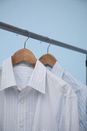 shirts on hangers: Shirts hang on hangers Stock Photo
