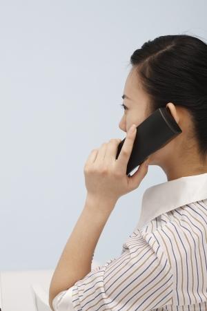 answered: Women answered the phone Stock Photo