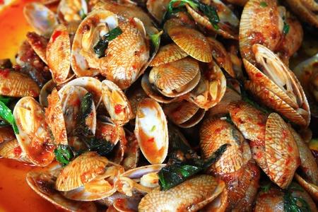 Stir fried enamel venus shell with curry paste