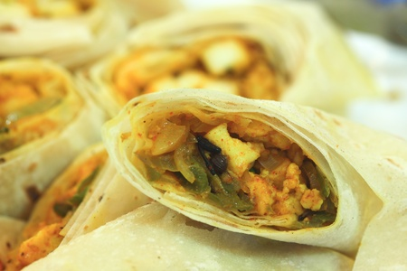 Spicy chicken  wrapped in roti bread  photo