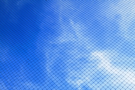 full frame background showing  blue sky and net photo