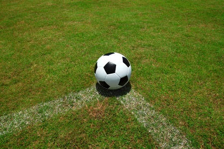 soccer ball and  field photo