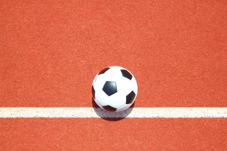 Soccer ball on  field photo
