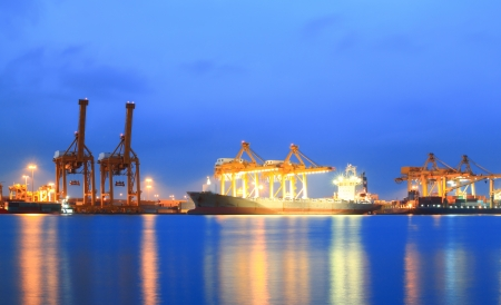 Stock Photo  Containers loading at sea trading port