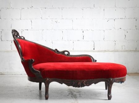 settee: Luxurious vintage red sofa Stock Photo