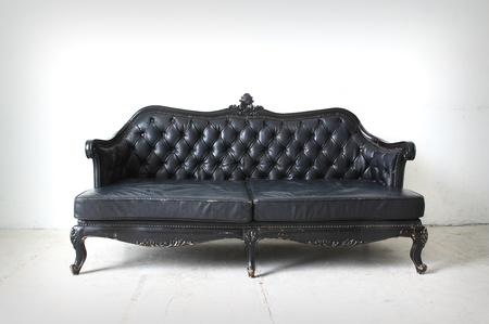 部屋のヴィンテージのソファ 写真素材