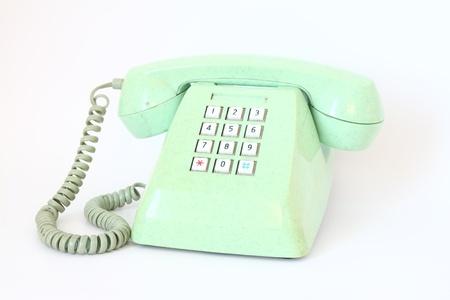 vintage telefoon geïsoleerd over een witte achtergrond