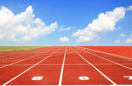 Running track with three lanes over sky and clouds  Stock Photo