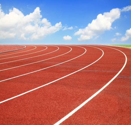 lane lines: Running track with lanes over sky and clouds