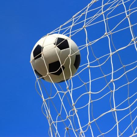football kick: soccer ball in goal