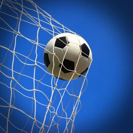 ゴールにサッカー ボール 写真素材