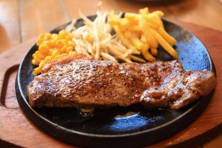 griddle: steak cooking on griddle plate