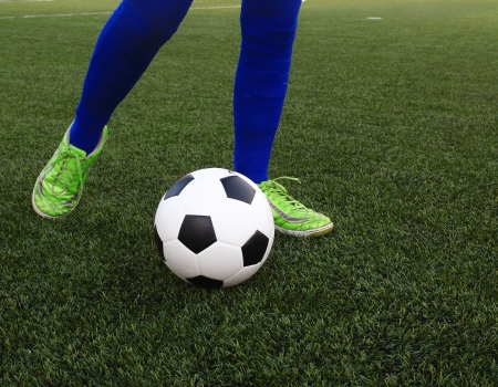 football cleats: Kicking the soccer ball
