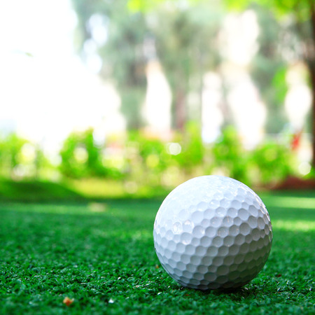 golf ball on green grass photo