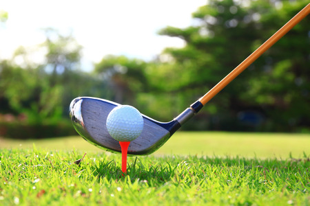 golf club: Golf balls and Driver on green grass background