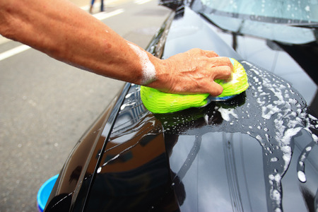 muck: hand hold sponge over the car for washing