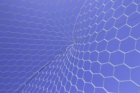 soccer net: Closeup of white soccer net over blue sky