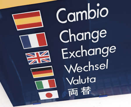 multilingual: Sign outside money exchange shop in six languages Stock Photo