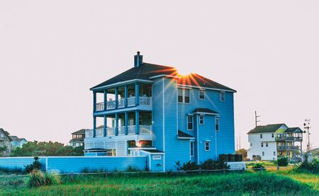 Summer sun setting behind an Outer Banks North Carolina vacation beach house