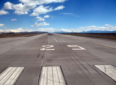 landing strip: Runway 25 of an airport close to the mountains