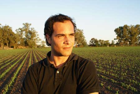 Portrait of a farmer in a corn field