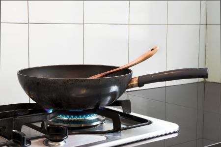 Fry pan on stove Stock Photo