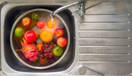 bowl sink: fruits cleaning Stock Photo