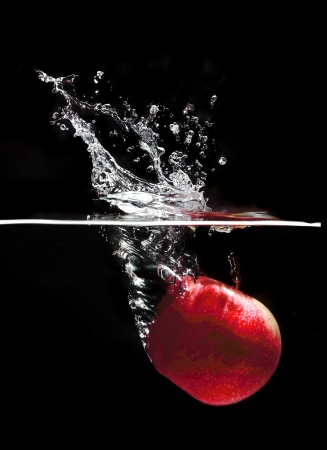apple drop to water  photo