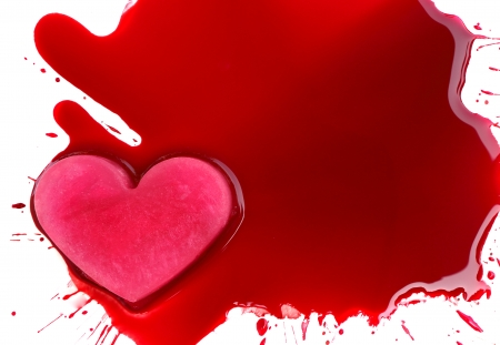 ice heart on blood photo
